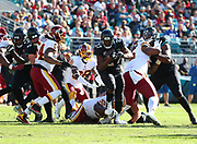 Dec 16, 2018; Jacksonville, FL, USA; Jacksonville Jaguars running back Leonard Fournette (27) breaks through the line of scrimmage during an NFL game at TIAA Bank Field against the Washington Redskins. The Redskins beat the Jaguars 16-13. (Steve Jacobson/Image of Sport)