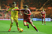 Middlesbrough forward, on loan from Watford, Diego Fabbrini  goes past Burnley midfielder George Boyd  during the Sky Bet Championship match between Middlesbrough and Burnley at the Riverside Stadium, Middlesbrough, England on 15 December 2015. Photo by Simon Davies.
