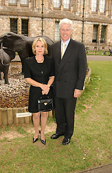 MR & MRS EDWARD ASPREY at a summer party held at The Natural History Museum entitled 'Evolution'  on 29tth June 2004.