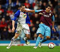 Photo: Paul Greenwood.<br />Blackburn Rovers v West Ham United. The Barclays Premiership. 17/03/2007.<br />West Ham's Carlos Tevez (R) holds off David Dunn