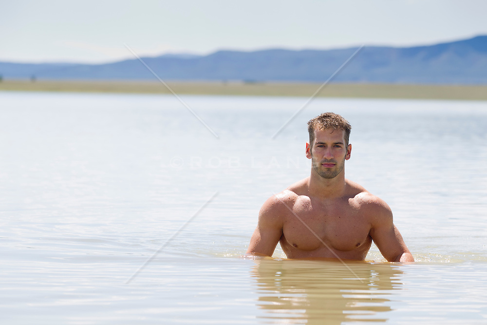 handsome man up to his chest in a beautiful lake in New Mexico