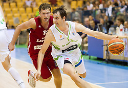 Janis Strelnieks of Latvia vs Domen Lorbek of Slovenia during friendly match between National teams of Slovenia and Latvia for Eurobasket 2013 on August 2, 2013 in Arena Zlatorog, Celje, Slovenia. (Photo by Vid Ponikvar / Sportida.com)