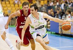 Janis Strelnieks of Latvia vs Domen Lorbek of Slovenia during friendly match between National teams of Slovenia and Latvia for Eurobasket 2013 on August 2, 2013 in Arena Zlatorog, Celje, Slovenia. (Photo by Vid Ponikvar / Sportida.com)