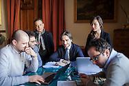27 Febbraio 2015, Reggio Calabria, Italia. Giuseppe Falcomatà, 31 anni, Sindaco di Reggio Calabria, lavora al tavolo del suo ufficio, circondato da i suoi più stretti collaboratori, poco prima della conferenza stampa in occasione dei primi novanta giorni di lavoro dal suo insediamento.