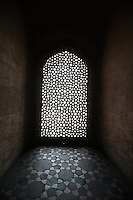 Light coming through stone lattice at Humayun's Tomb, New Delhi, India