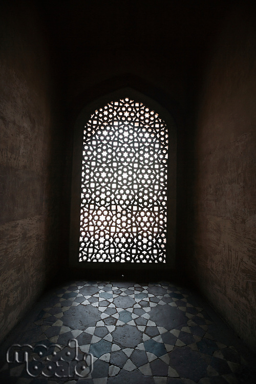 Light coming through stone lattice at Humayun's Tomb, New Delhi, India