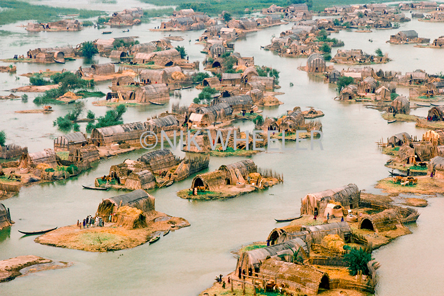 aerial view of Marsh Arab reed houses in the marshlands of Iraq where the Tigris and Euphrates Rivers meet