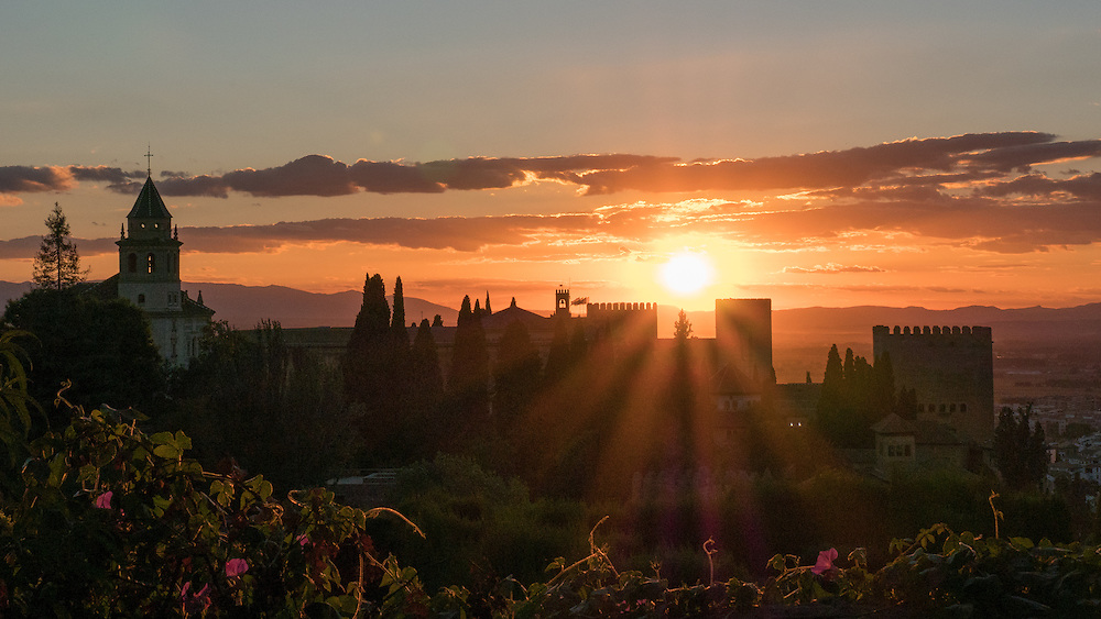 . The Alhambra, the complete Arabic form of which was Qalat Al-Hamra, is a palace and fortress complex located in Granada, Andalusia, Spain.