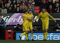 Photo: Lee Earle.<br /> Charlton Athletic v Liverpool. The Barclays Premiership. 16/12/2006. Liverpool's Steven Gerrard (C) is congratulated after scoring their third.