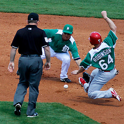 March 17, 2012; Lakeland, FL, USA; St. Louis Cardinals center fielder Shane Robinson (64) is caught stealing by Detroit Tigers second baseman Ryan Raburn (25) during the top of the second inning of a spring training game at Joker Marchant Stadium. Both teams wore green jerseys and the field was marked with shamrocks for the St. Patrick's Day game. Mandatory Credit: Derick E. Hingle-US PRESSWIRE