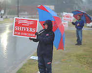 Emily Shivers holds a campaign sign as voters go to the polls in the rain at the National Guard Armory in Oxford, Miss. on Tuesday, November 2, 2010.
