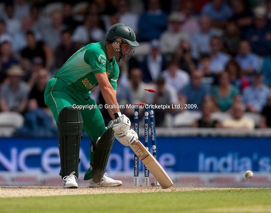 Albie Morkel is bowled by Jerome Taylor during the ICC World Twenty20 Cup match between South Africa and West Indies at the Oval. Photo © Graham Morris (Tel: +44(0)20 8969 4192 Email: sales@cricketpix.com)