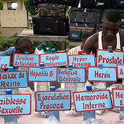 April 2008 - A man in Cotonou, Benin, sells herbal medicines designed to relieve AIDS symptoms, Sexual problems, diabetes, ulcer, ....