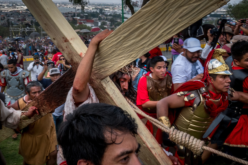 27-year-old Eder Omar Arreola Ortega, the actor playing Jesus in this year's Passion of the Christ parade, carries his wooden cross to the summit of Cerro de Estrella. Being chosen to play Jesus is seen as a huge honor and the actor must train up to six months in advance for the phycial feat of dragging a 100kg (220 lb.) piece of wood up hill in the sun.