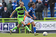 Forest Green Rovers Joseph Mills(23) passes the ball forward during the EFL Sky Bet League 2 match between Forest Green Rovers and Macclesfield Town at the New Lawn, Forest Green, United Kingdom on 13 April 2019.