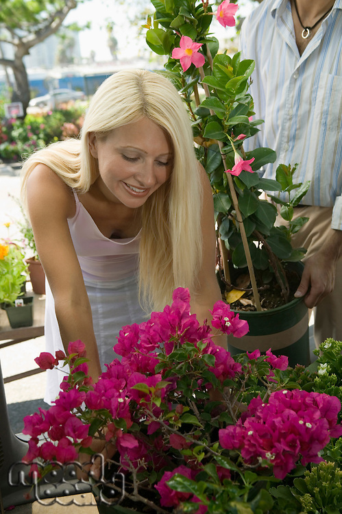 Woman Shopping for Flowers at plant nursery