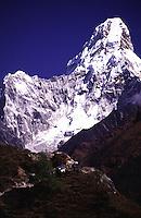 Mt Ama Dablam towers over a train of yaks outside of Namche in the Sagarnatha National Park, Sollu Khumbu region of Nepal.