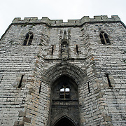 The main gatehouse at Caernarfon Castle in northwest Wales. A castle originally stood on the site dating back to the late 11th century, but in the late 13th century King Edward I commissioned a new structure that stands to this day. It has distinctive towers and is one of the best preserved of the series of castles Edward I commissioned.
