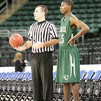 Forward Gizzle Uzendu (15) waits for the ball from the referee.