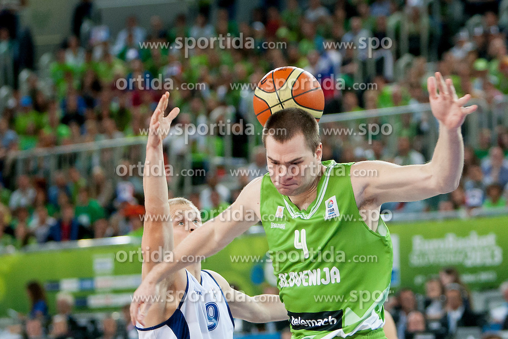 Sasu Salin #9 of Finland vs Uros Slokar of Slovenia during basketball match between National teams of Finland and Slovenia in 2nd Round at Day 13 of Eurobasket 2013 on September 14, 2013 in SRC Stozice, Ljubljana, Slovenia. (Photo By Urban Urbanc / Sportida)