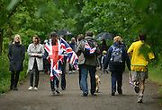 © Licensed to London News Pictures. 03/06/2012. London, UK. Many people walked along the Thames river banks to the centre of London. Boats gather at Hammersmith and Putney at their muster points before taking part in the Jubilee Padgeant. The Royal Jubilee celebrations. Great Britain is celebrating the 60th  anniversary of the countries Monarch HRH Queen Elizabeth II accession to the throne this weekend Photo credit : Stephen Simpson/LNP