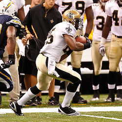 August 27, 2010; New Orleans, LA, USA; New Orleans Saints running back Reggie Bush (25) is pursued by San Diego Chargers linebacker Brandon Siler (59) during the first half of a preseason game at the Louisiana Superdome. The New Orleans Saints defeated the San Diego Chargers 36-21. Mandatory Credit: Derick E. Hingle
