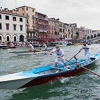 VENICE, ITALY - SEPTEMBER 04:  Young rowers on traditional Venetian boats take part in one of the races of the Historic Regata on September 4, 2011 in Venice, Italy. The Historic Regata is the most popular boat race on the Gran Canal for locals and tourists alike.