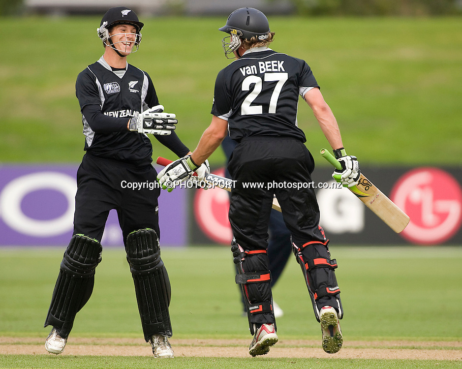 New Zealand's final batting peer Ben Wheeler and Logan van Beek celebrate the win. New Zealand v England, U19 Cricket World Cup SL 7th-8th Place, Village Green, QEII, Christchurch, Tuesday 26 January 2010. Photo : Joseph Johnson/PHOTOSPORT
