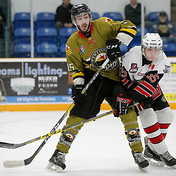 "TRENTON, ON  - MAY 4,  2017: Canadian Junior Hockey League, Central Canadian Jr. ""A"" Championship. The Dudley Hewitt Cup. Game 5 between The Georgetown Raiders and The Powassan Voodoos.  Ryan Theriault #15 of the Powassan Voodoos and Luke Beamish #55 of the Georgetown Raiders battle for position during the first period <br /> (Photo by Amy Deroche / OJHL Images)"