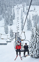 Ski lift and skiiers on the back side of Stevens Pass ski area, Washington Central Cascades