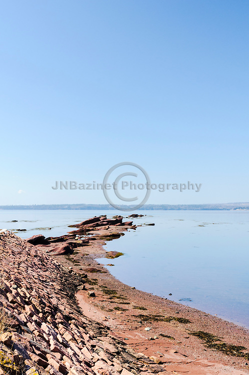 Red rocks line the shores of Pottery Cove in St-Andrews Harbour, New Brunswick Canada