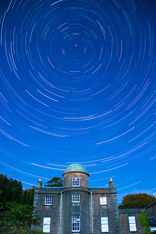 Star Trails at Armagh Observatory under the near full moon. Image made up of a series of 30s exposures taken over a period of about 1.5 hours. The rotation of the Earth causes the apparent position of the stars to rotate around the direction of the Earth's rotational axis - approximately the position of Polaris - a relative motion that can be captured on camera.
