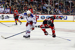February 1, 2008; Newark, NJ, USA;  New York Rangers defenseman Michal Rozsival (3) delivers a hip check to New Jersey Devils center Dainius Zubrus (16) during the second period at the Prudential Center in Newark, NJ.