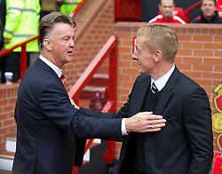 16-08-2014 ENG: Premier League, Manchester United vs Swansea City, Manchester<br /> Manchester United's manager Louis van Gaal and Swansea City's manager Garry Monk<br /> <br /> ***NETHERLANDS ONLY***