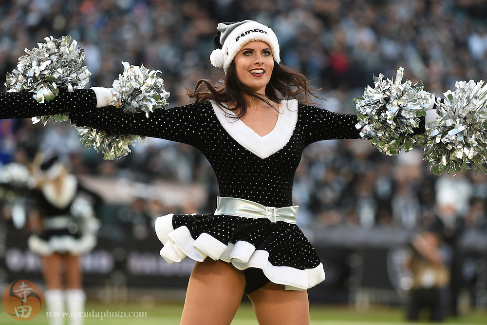 December 21, 2014; Oakland, CA, USA; Oakland Raiders Raiderettes cheerleader Brittany performs in Santa outfits for Christmas during the third quarter against the Buffalo Bills at O.co Coliseum. The Raiders defeated the Bills 26-24.