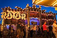 DEU, Germany, Duesseldorf, fun fair at the banks of the river Rhine in the town district Oberkassel, the ride Rotor [the Rotor is a large rotating drum where the visitors are standing with their backs to the wall. When the rotation of the drum is fast enough the floor drives down. By the centrifugal force the visitor cleaves at the wall, the centrifugal force defeats the gravitation force].<br /> <br /> DEU, Deutschland, Duesseldorf, Kirmes auf den Rheinwiesen im Stadtteil Oberkassel, das Fahrgeschaeft Rotor der Schaustellerfamilie Pluschies [der Rotor ist eine grosse sich drehende Trommel, bei der der Besucher sich mit dem Ruecken zur Wand stellt. Dreht sich die Trommel schnell genug, wird der Boden nach unten gefahren. Der Besucher klebt durch die Fliehkraft an der Wand, die Fliehkraft siegt ueber die Schwerkraft] .