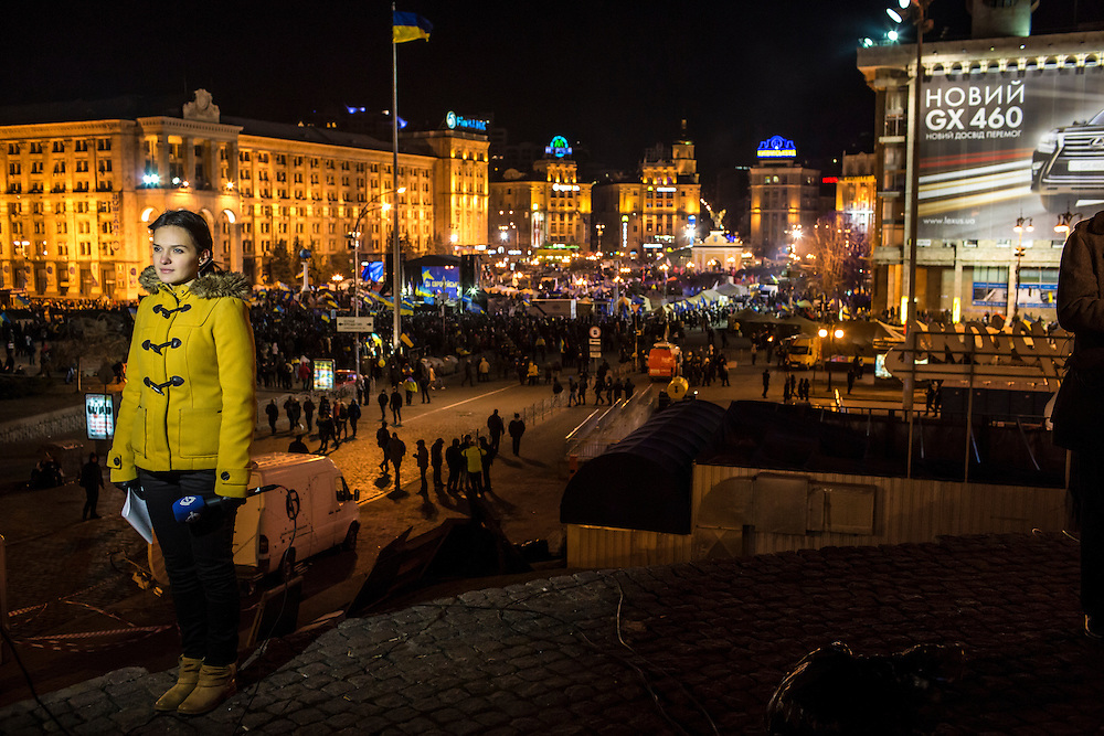 KIEV, UKRAINE - DECEMBER 3: A television reporter prepares to report on anti-government protests in Independence Square on December 3, 2013 in Kiev, Ukraine. Thousands of people have been protesting against the government since a decision by Ukrainian president Viktor Yanukovych to suspend a trade and partnership agreement with the European Union in favor of incentives from Russia. (Photo by Brendan Hoffman/Getty Images) *** Local Caption ***