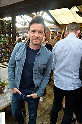 SHANE FILAN at the Warner Music Group Summer Party in association with British GQ held at Shoreditch House, Ebor Street, London E2 on 8th July 2015.