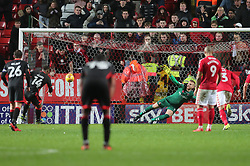 Milton Keynes Dons Kieran Agard (14) scores his penalty during the Sky Bet League One match at The Valley, Charlton.