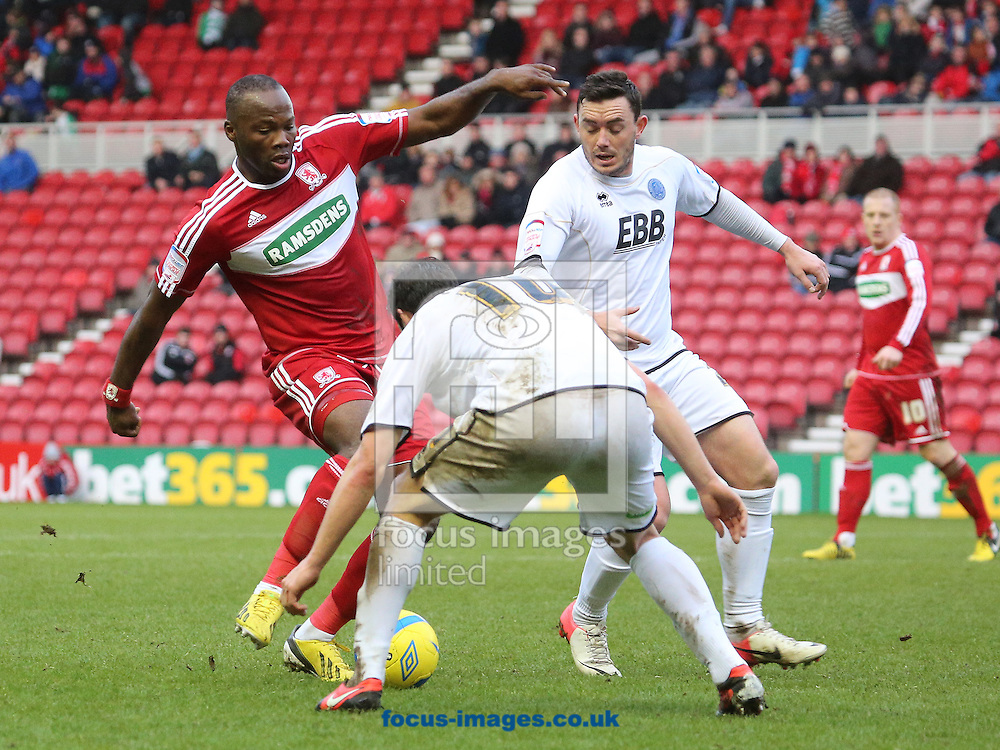 Picture by Paul Gaythorpe/Focus Images Ltd +447771 871632.26/01/2013.Andre Bikey of Middlesbrough and Danny Hylton and Craig Reed of Aldershot Town during the FA Cup match at the Riverside Stadium, Middlesbrough.