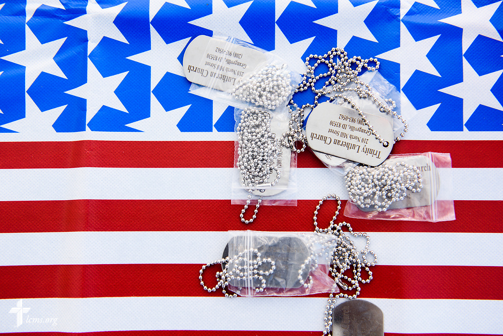 Dog tags are laid out for passing visitors at the Trinity Lutheran Church, Grangeville, Idaho, TLC4Vets outreach tent at the Grangeville Border Days Independence Day celebration and parade on Tuesday, July 4, 2017, in Grangeville. LCMS Communications/Erik M. Lunsford