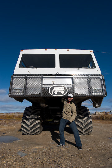 Cesar Ruano, PBI Leadership Student, mugs in front of a Tundra Buggy. Churchill, Manitoba
