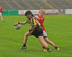 Parke&rsquo;s Cathal Keaveney tries to get past Belmullet&rsquo;s Rian Concannon during U14 B Championship final at Mac Hale Park.<br />
