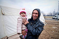 Iraqi child  in her father's arms while on their way with a bus from Athens to Idomeni village at the Greek - Macedonian border, 8 Febraury 2016. Hundreds of refugees  wait every day at a gas station used as a temporary camp outside of Polykastro city at the north part of Greece until they receive the order from the police to move to the Greece- Macedonian border and continue their trip  to North Europe.