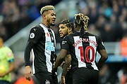 DeAndre Yedlin (#22) of Newcastle United celebrates Newcastle United's first goal (1-1) with Joelinton (#9) of Newcastle United and Allan Saint-Maximin (#10) of Newcastle United during the Premier League match between Newcastle United and Bournemouth at St. James's Park, Newcastle, England on 9 November 2019.