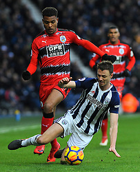 Steve Mounie of Huddersfield Town fouls Jonny Evans of West Bromwich Albion - Mandatory by-line: Nizaam Jones/JMP - 24/02/2018 - FOOTBALL - The Hawthorns - West Bromwich, England - West Bromwich Albion v Huddersfield Town- Premier League