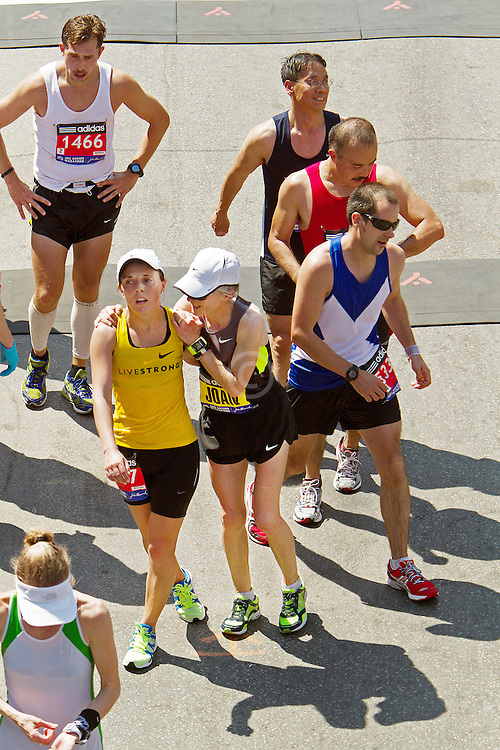 Joan Benoit Samuelson hugs daughter Abby Samuelson after crossing finsih line in Boston Marathon