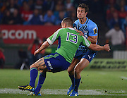 PRETORIA, South Africa, 18 MAY 2013 : JJ Engelbrecht of the Bulls is tackled by Tamati Ellison of the Highlanders during the SupeRugby match between the BULLS and the HIGHLANDERS at Loftus Versfeld in Pretoria, South Africa on 18 MAY 2013. Bulls 35 - 18 Highlanders.<br /> <br /> © Anton de Villiers / SASPA