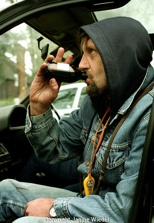 Heroin addict sitting in the car taking his prescription Methodone.