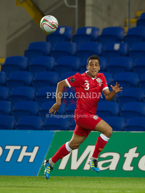 CARDIFF, WALES - Friday, September 2, 2011: Wales' Neil Taylor in action against Montenegro during the UEFA Euro 2012 Qualifying Group G match at the  Cardiff City Stadium. (Pic by David Rawcliffe/Propaganda)